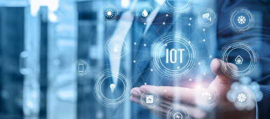 Businessman showing iot structure on blurred background.